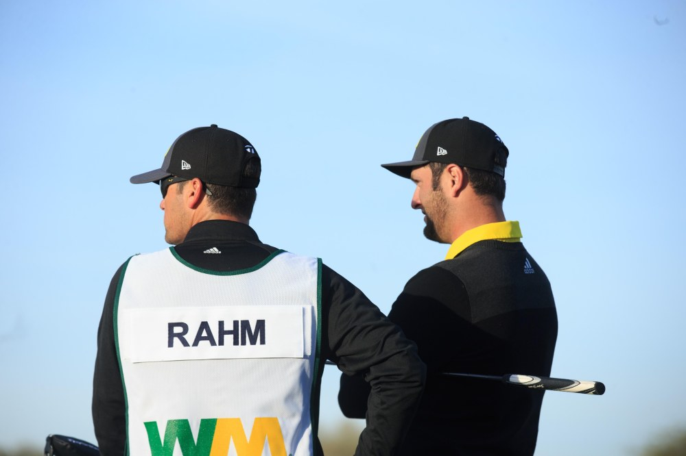 Feb 2, 2017; Scottsdale, AZ, USA; Jon Rahm (right) with his caddy in the fairway of the 11th during the first round of the Waste Management Phoenix Open golf tournament at TPC Scottsdale. Mandatory Credit: Allan Henry-USA TODAY Sports