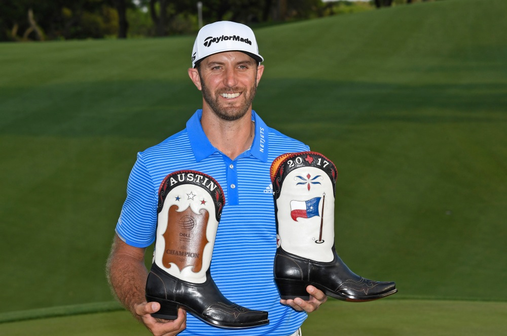 AUSTIN, TX - MARCH 26: Dustin Johnson poses with a pair of custom cowboy boots after winning the World Golf Championships - Dell Technologies Match Play at Austin Country Club on March 26, 2017 in Austin, Texas. (Photo by Chris Condon/PGA TOUR)