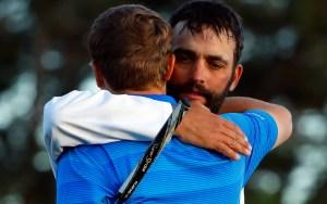 Jordan Spieth and caddie Michael Greller hug after the 2016 Masters.
