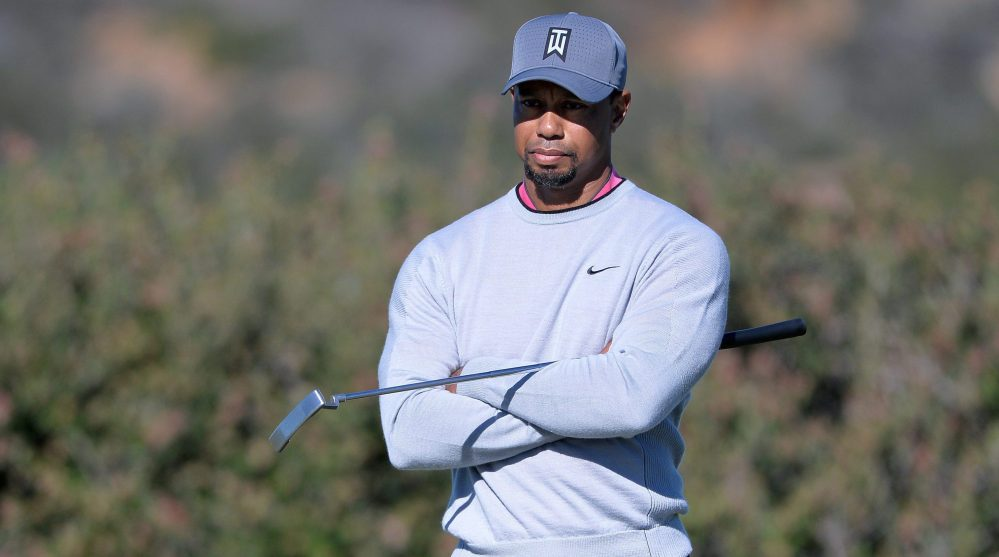 Jan 27, 2017; La Jolla, CA, USA; Tiger Woods awaits his turn on the 12th green during the second round of the Farmers Insurance Open golf tournament at Torrey Pines Municipal Golf Course - North Co. Mandatory Credit: Orlando Ramirez-USA TODAY Sports