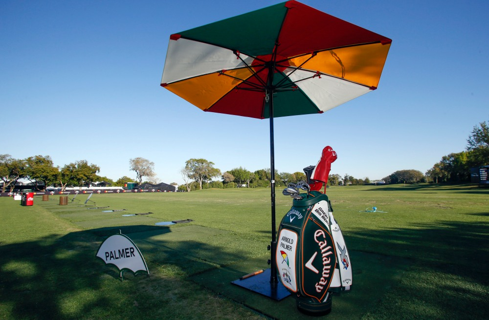 Mar 16, 2017; Orlando, FL, USA; A tee box on the range is reserved containing a golf bag and umbrella for Arnold Palmer during the first round of the Arnold Palmer Invitational golf tournament at Bay Hill Club and Lodge. Mandatory Credit: Reinhold Matay-USA TODAY Sports