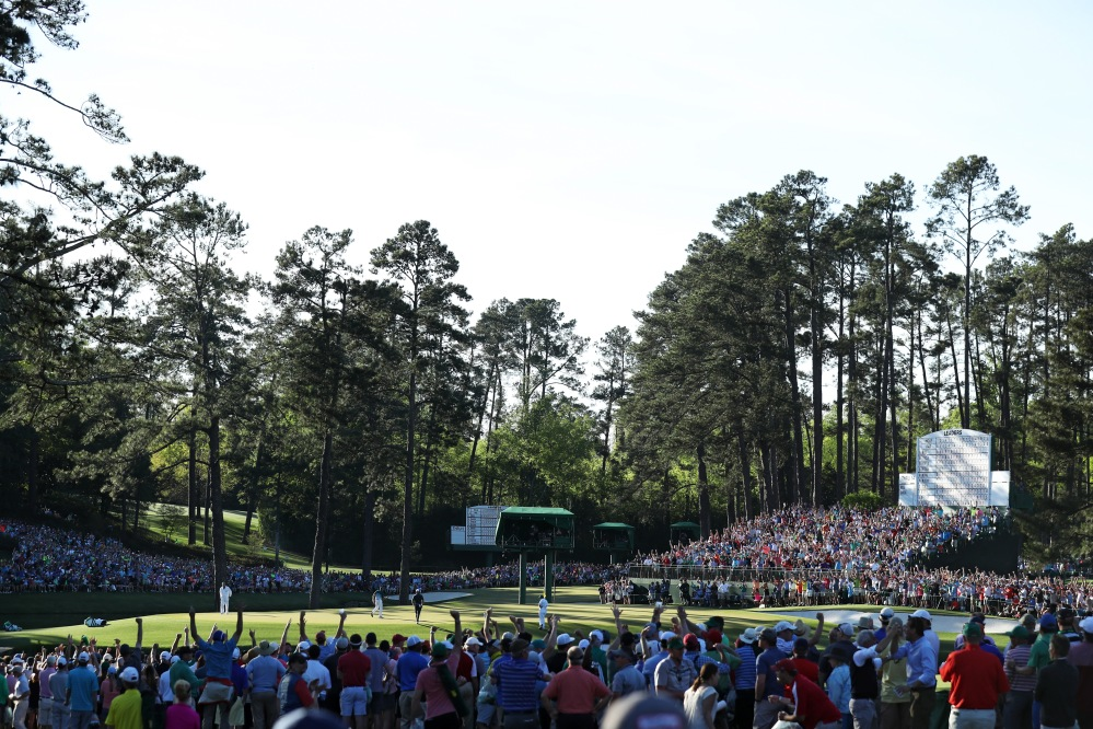 AUGUSTA, GA - APRIL 09: Patrons cheer as Sergio Garcia of Spain celebrates making a putt for eagle on the 15th hole during the final round of the 2017 Masters Tournament at Augusta National Golf Club on April 9, 2017 in Augusta, Georgia. (Photo by David Cannon/Getty Images)