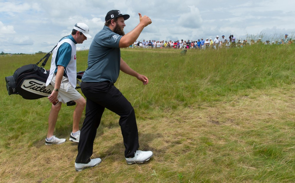 "Jun 17, 2017; Hartford, WI, USA; Andrew Johnston responds to cheers of ""Beef"" while walking to the first tee during the third round of the 2017 U.S. Open Championship at Erin Hills. Mandatory Credit: Mark Hoffman/Milwaukee Journal Sentinel via USA TODAY NETWORK"