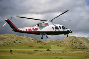 ABERDEEN, SCOTLAND - JUNE 25: Presumptive Republican nominee for US president Donald Trump arrives in a helicopter at Trump International Golf Links on June 25, 2016 in Aberdeen, Scotland. The US presidential hopeful was in Scotland for the reopening of the refurbished Open venue golf resort Trump Turnberry which has undergone an eight month refurbishment as part of an investment thought to be worth in the region of two hundred million pounds. (Photo by Jeff J Mitchell/Getty Images)