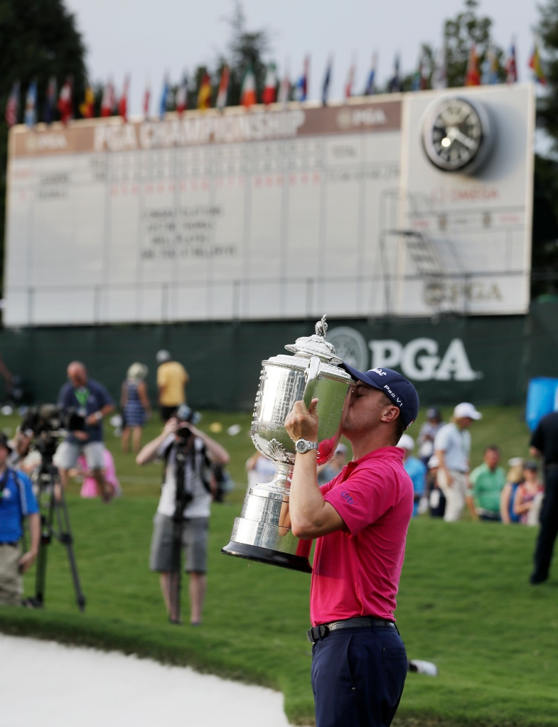 Justin Thomas poses with the Wanamaker Trophy after winning the PGA Championship golf tournament at the Quail Hollow Club Sunday, Aug. 13, 2017, in Charlotte, N.C. (AP Photo/John Bazemore)