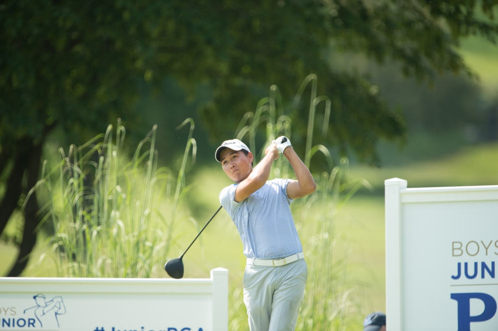 ST. ALBANS, MO - AUGUST 02: Daulet Tuleubayev hits his tee shot on the 18th hole during Round Three for the 42nd Boys Junior PGA Championship held at the Country Club of St. Albans on August 2, 2017 in St. Albans Missouri. (Photo by Montana Pritchard/PGA of America)