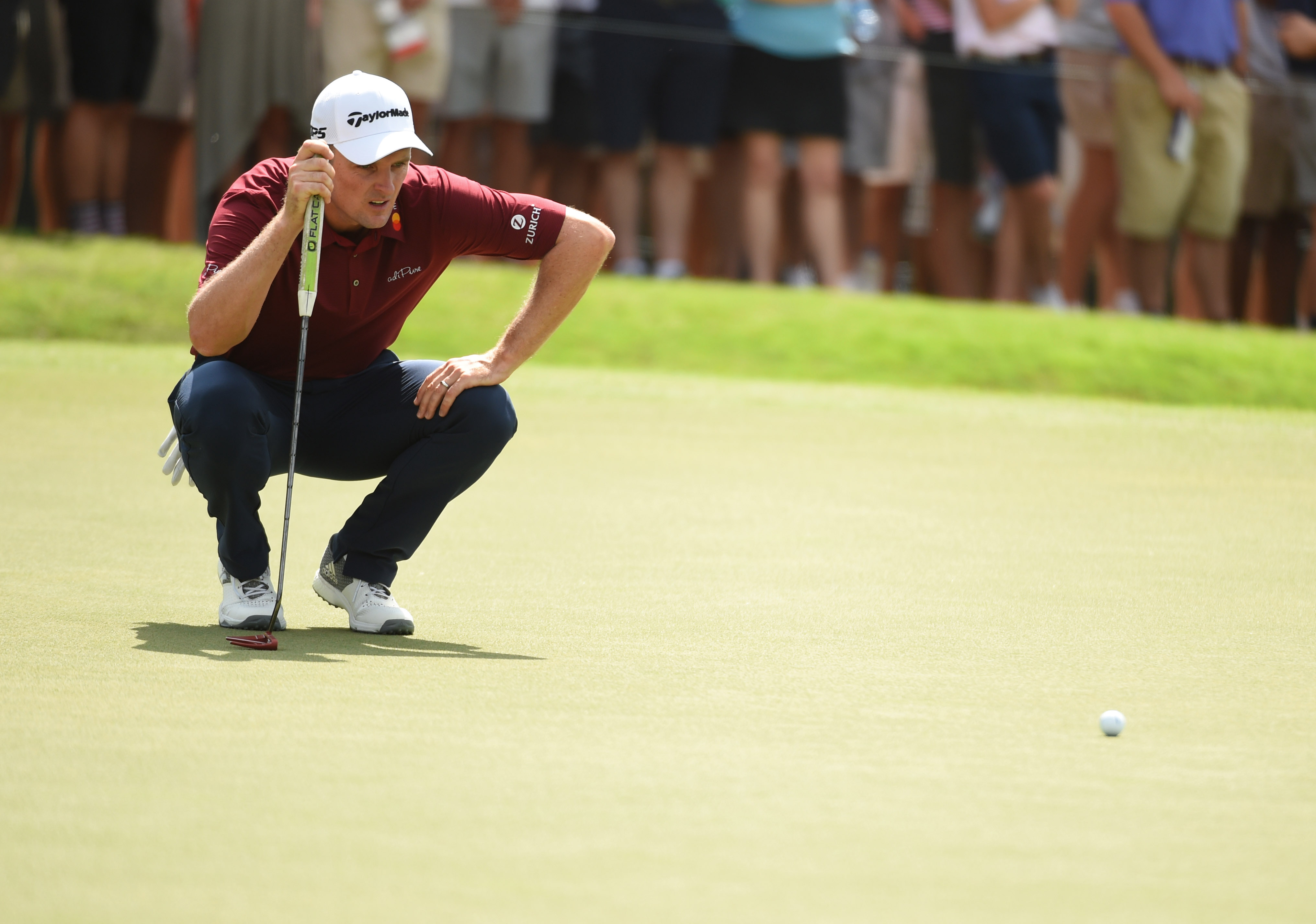 Sep 23, 2018; Atlanta, GA, USA; Justin Rose lines up his putt on the fourth green during the final round of the Tour Championship golf tournament at East Lake Golf Club. Mandatory Credit: John David Mercer-USA TODAY Sports
