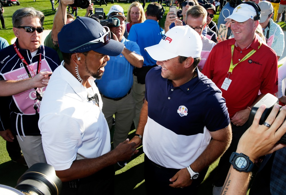 CHASKA, MN - OCTOBER 02: Vice-captain Tiger Woods celebrates with Patrick Reed of the United States after winning the Ryder Cup during singles matches of the 2016 Ryder Cup at Hazeltine National Golf Club on October 2, 2016 in Chaska, Minnesota. (Photo by Sam Greenwood/Getty Images)