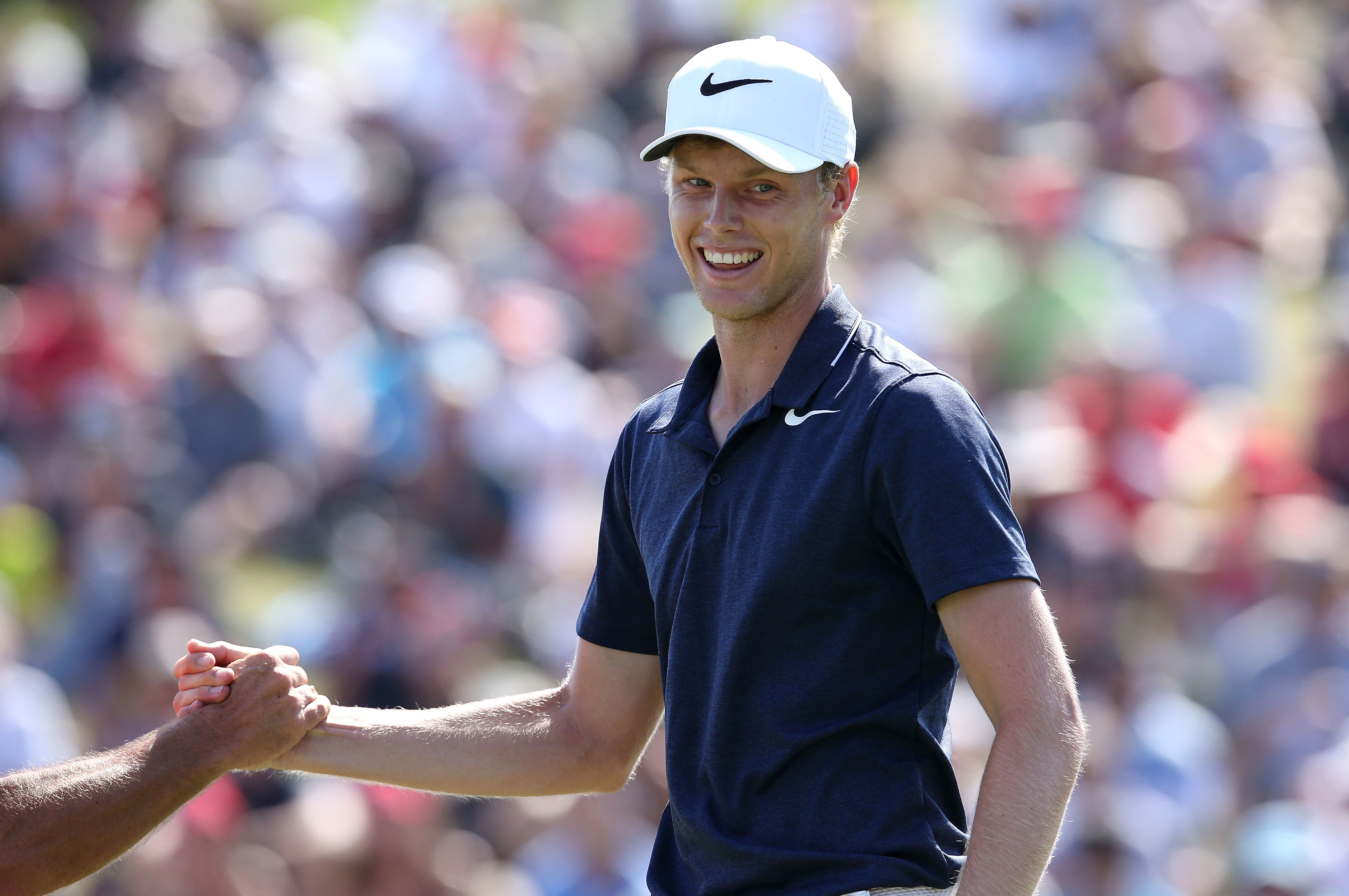 SYDNEY, AUSTRALIA - NOVEMBER 26: Cameron Davis of Australia celebrates holing a putt on the 18th hole during day four of the 2017 Australian Golf Open at the Australian Golf Club on November 26, 2017 in Sydney, Australia. (Photo by Jason McCawley/R&A/R&A via Getty Images)
