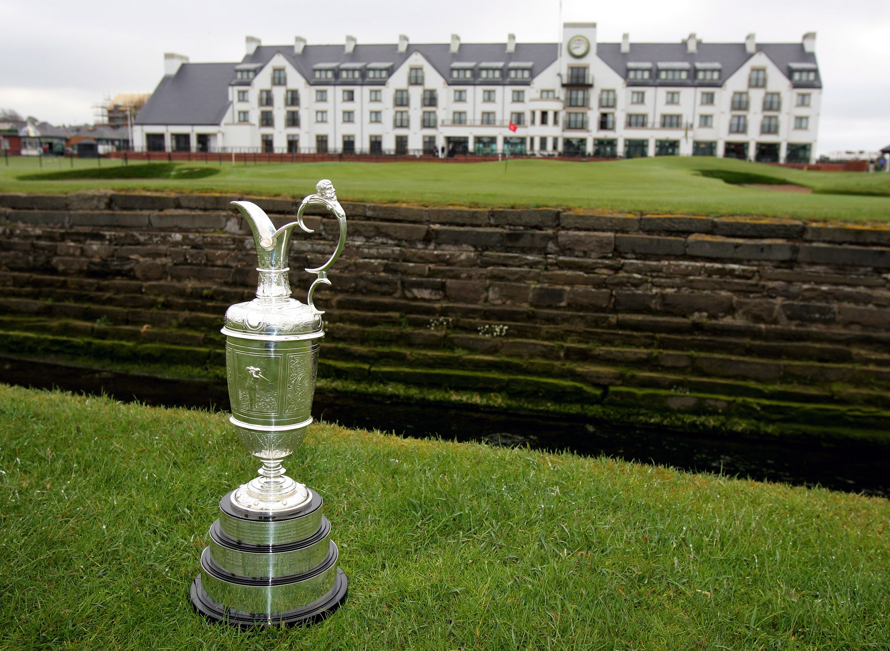 CARNOUSTIE, UNITED KINGDOM - MAY 01: A close-up of the claret jug trophy in front of the clubhouse prior to The Open Championship press conference held at Carnoustie Golf Club on May 1, 2007 in Carnoustie, Scotland. (Photo by Andrew Redington/Getty Images)