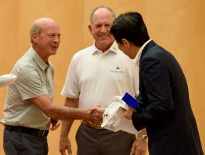 Professional Golfers' Association (PGA) senior member Larry Nelson (L) shakes hands with Japanese Prime Minister Shinzo Abe (R) as fellow senior PGA member Scott McCarron (C) looks on during their courtesy call at Abe's official residence in Tokyo on September 5, 2017. / AFP PHOTO / TORU YAMANAKA (Photo credit should read TORU YAMANAKA/AFP/Getty Images)