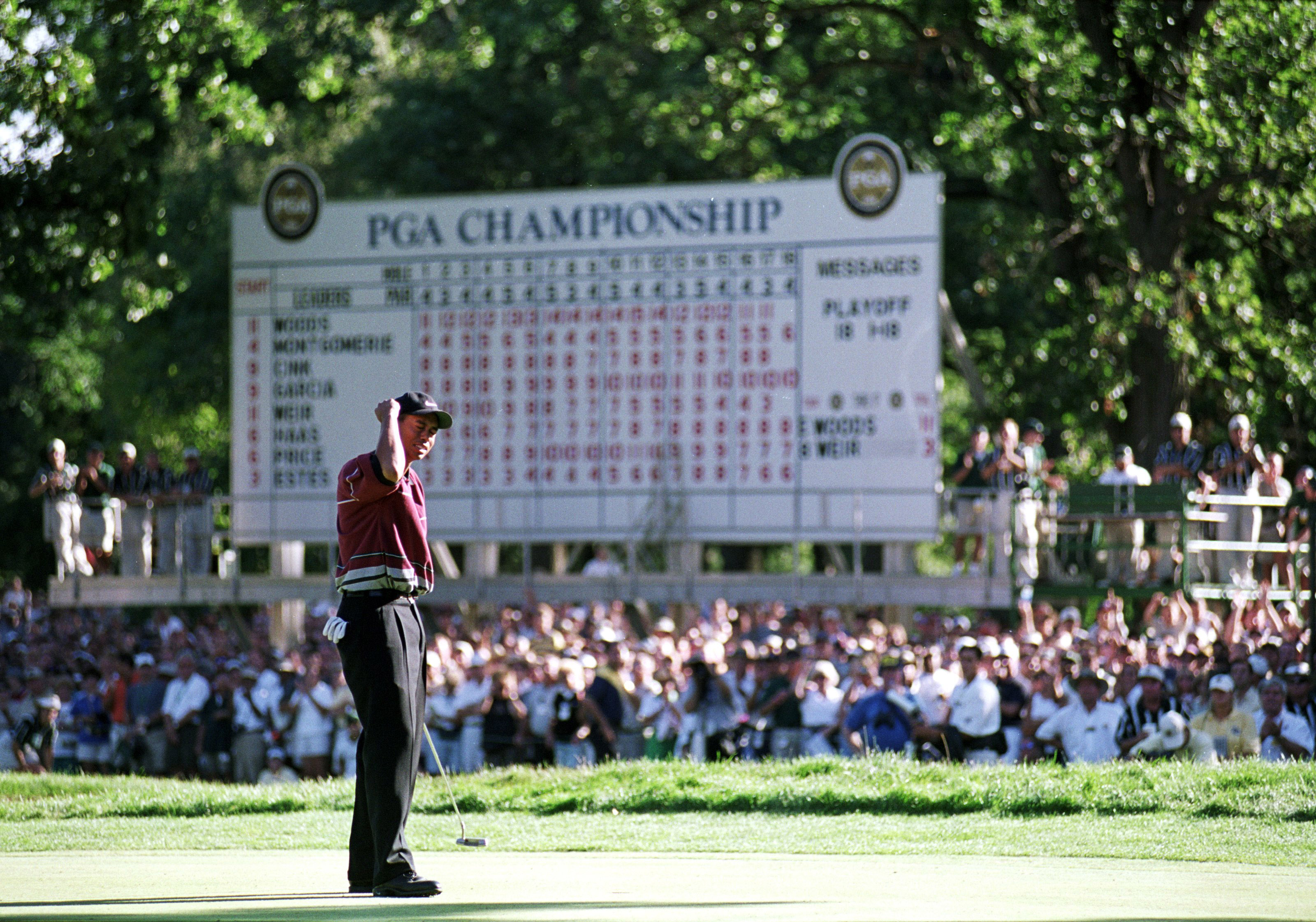 15 Aug 1999: Tiger Woods celebrates as he makes the winning putt during the PGA Championships at the Medinah Country Club in Medinah, Illinois. Mandatory Credit: Harry How /Allsport