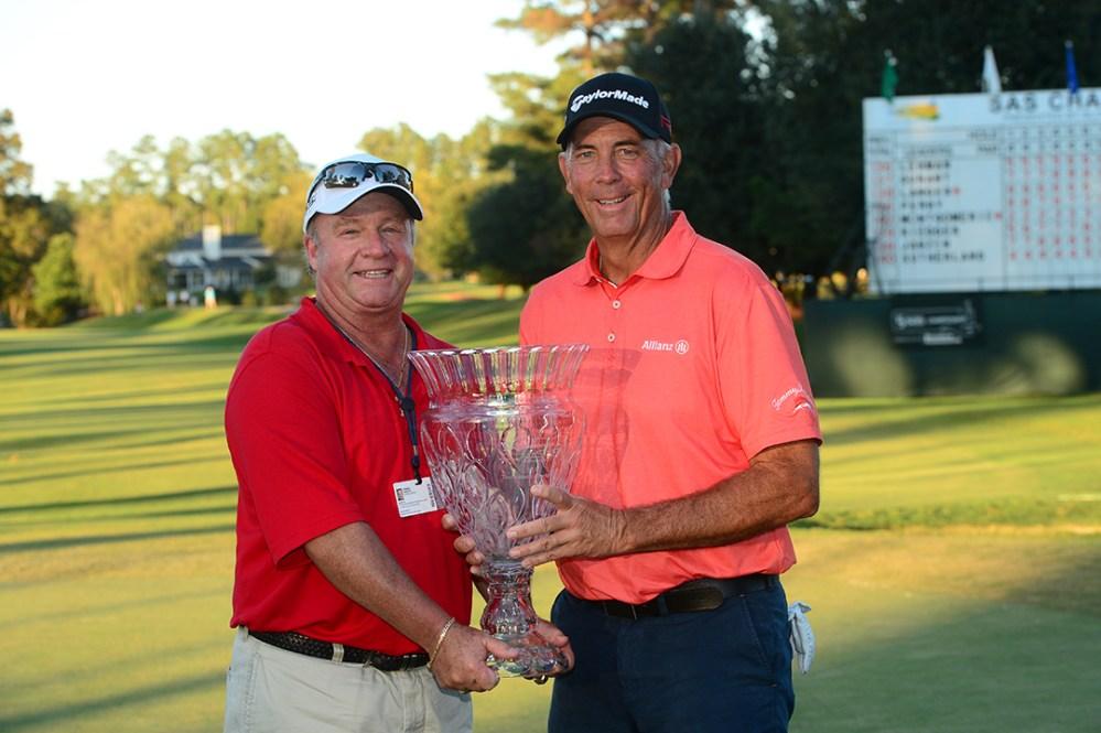 Dennis Trixler and Tom Lehman hold the trophy after Lehman wins 2015 SAS Championship.