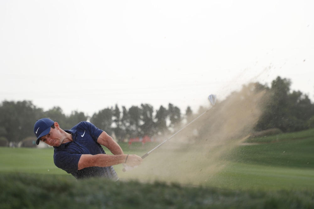 ABU DHABI, UNITED ARAB EMIRATES - JANUARY 21: Rory McIlroy of Northern Ireland plays his second shot from a bunker on the 13th hole during the final round of the Abu Dhabi HSBC Golf Championship at Abu Dhabi Golf Club on January 21, 2018 in Abu Dhabi, United Arab Emirates. (Photo by Matthew Lewis/Getty Images)