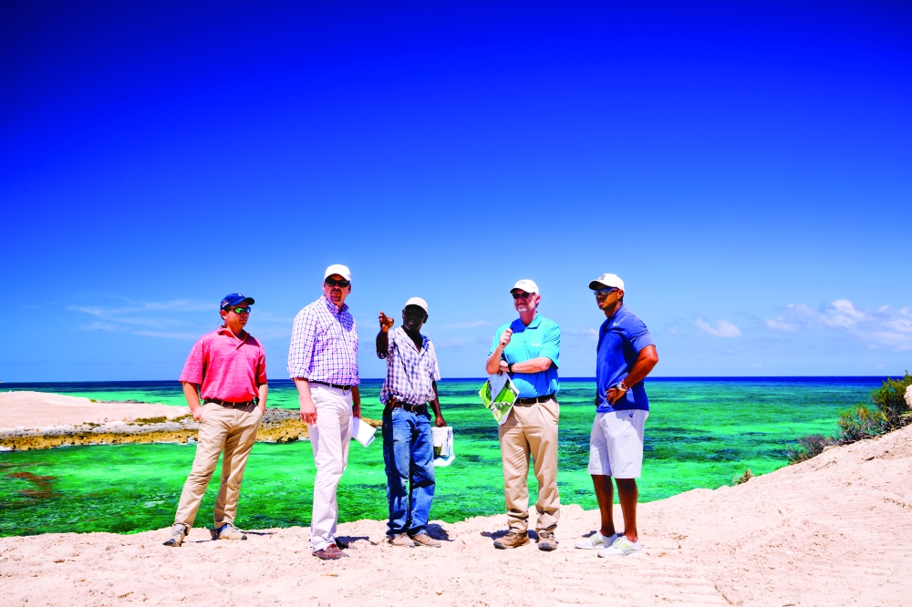 Tiger Woods, right, with his design team at Jack's Bay