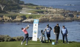 Rory McIlroy, of Northern Ireland. hits from the fourth tee of the Spyglass Hill Golf Course during the first round of the AT&T Pebble Beach National Pro-Am golf tournament Thursday, Feb. 8, 2018, in Pebble Beach, Calif. Looking on, second from right, is Phil Mickelson and at right is Jimmy Dunne III. (AP Photo/Eric Risberg)