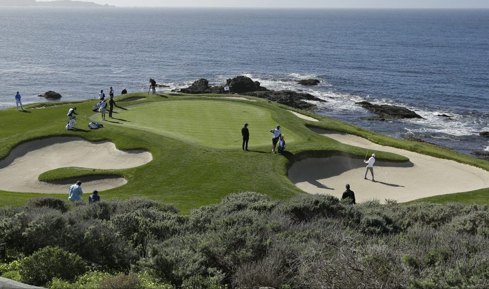 Jordan Spieth, right, hits out a bunker onto the seventh green of the Pebble Beach Golf Links during the third round of the AT&T Pebble Beach National Pro-Am golf tournament Saturday, Feb. 10, 2018, in Pebble Beach, Calif. (AP Photo/Eric Risberg)