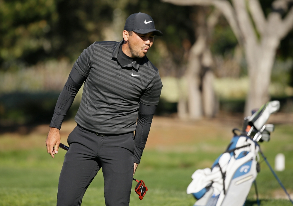 Jason Day, of Australia, reacts after missing an eagle putt on the second green of the Pebble Beach Golf Links during the final round of the AT&T Pebble Beach National Pro-Am golf tournament Sunday, Feb. 11, 2018, in Pebble Beach, Calif. (AP Photo/Eric Risberg)