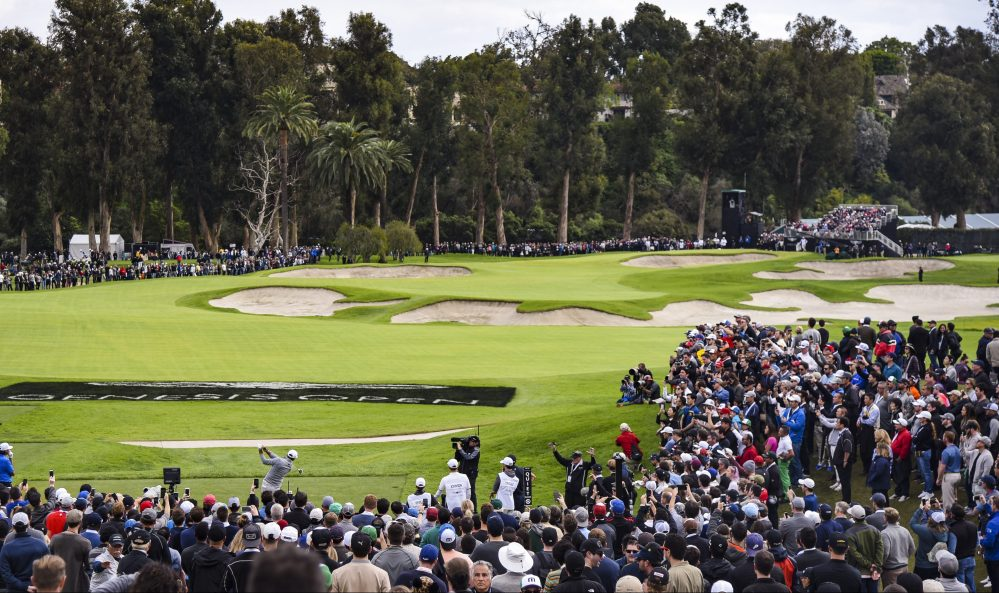 PACIFIC PALISADES, CA - FEBRUARY 19: Dustin Johnson tees off on the 10th hole as fans watch during the final round of the Genesis Open at Riviera Country Club on February 19, 2017 in Pacific Palisades, California. (Photo by Keyur Khamar/PGA TOUR)