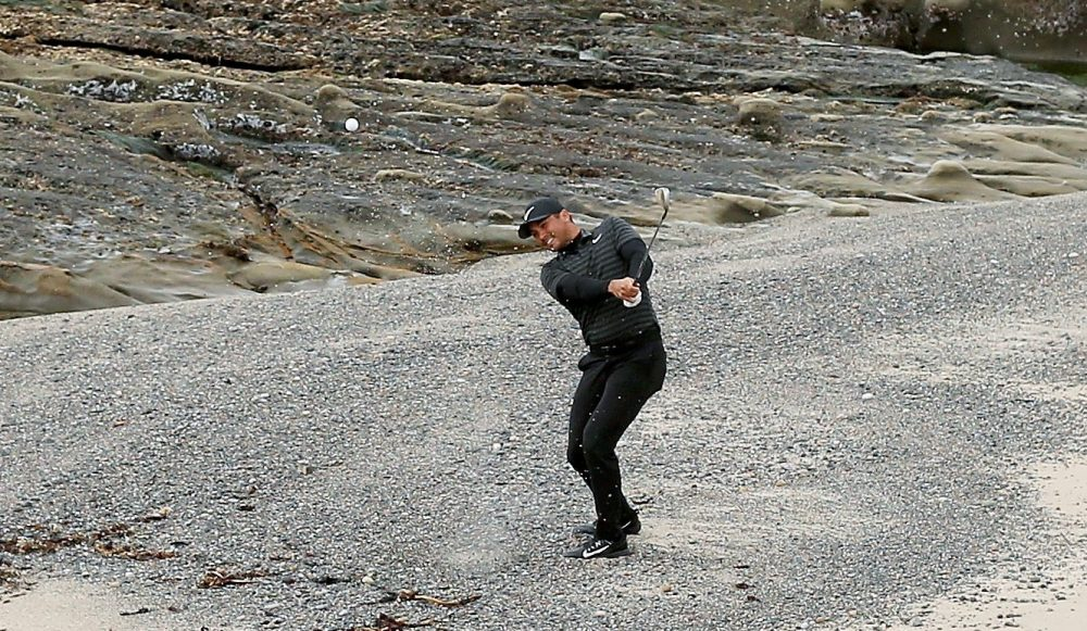 PEBBLE BEACH, CA - FEBRUARY 11: Jason Day of Australia plays his shot from the beach near the 18th hole during the Final Round of the AT&T Pebble Beach Pro-Am at Pebble Beach Golf Links on February 11, 2018 in Pebble Beach, California. (Photo by Dylan Buell/Getty Images)