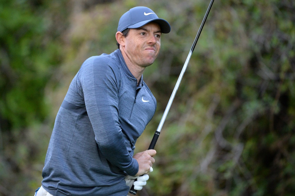 Feb 15, 2018; Pacific Palisades, CA, USA; Rory McIlroy reacts after teeing off the 12th hole during the first round of the Genesis Open golf tournament at Riviera Country Club. Mandatory Credit: Orlando Ramirez-USA TODAY Sports