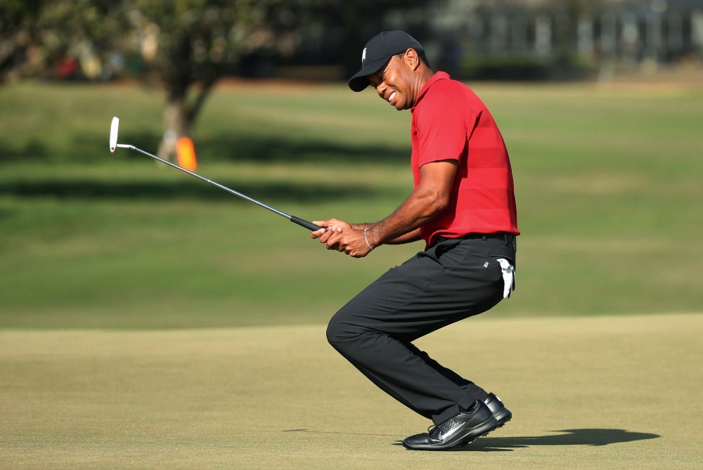 Tiger Woods grimaces after missing a putt on the 15th green during the final round of the Arnold Palmer Invitational golf tournament Sunday, March 18, 2018, in Orlando, Fla. (Stephen M. Dowell/Orlando Sentinel via AP)