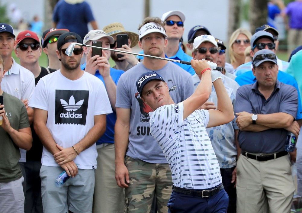 PALM BEACH GARDENS, FL - FEBRUARY 22: Justin Thomas of the United States plays his second shot on the ninth hole during the first round of the 2018 Honda Classic on The Champions Course at PGA National on February 22, 2018 in Palm Beach Gardens, Florida. (Photo by David Cannon/Getty Images)