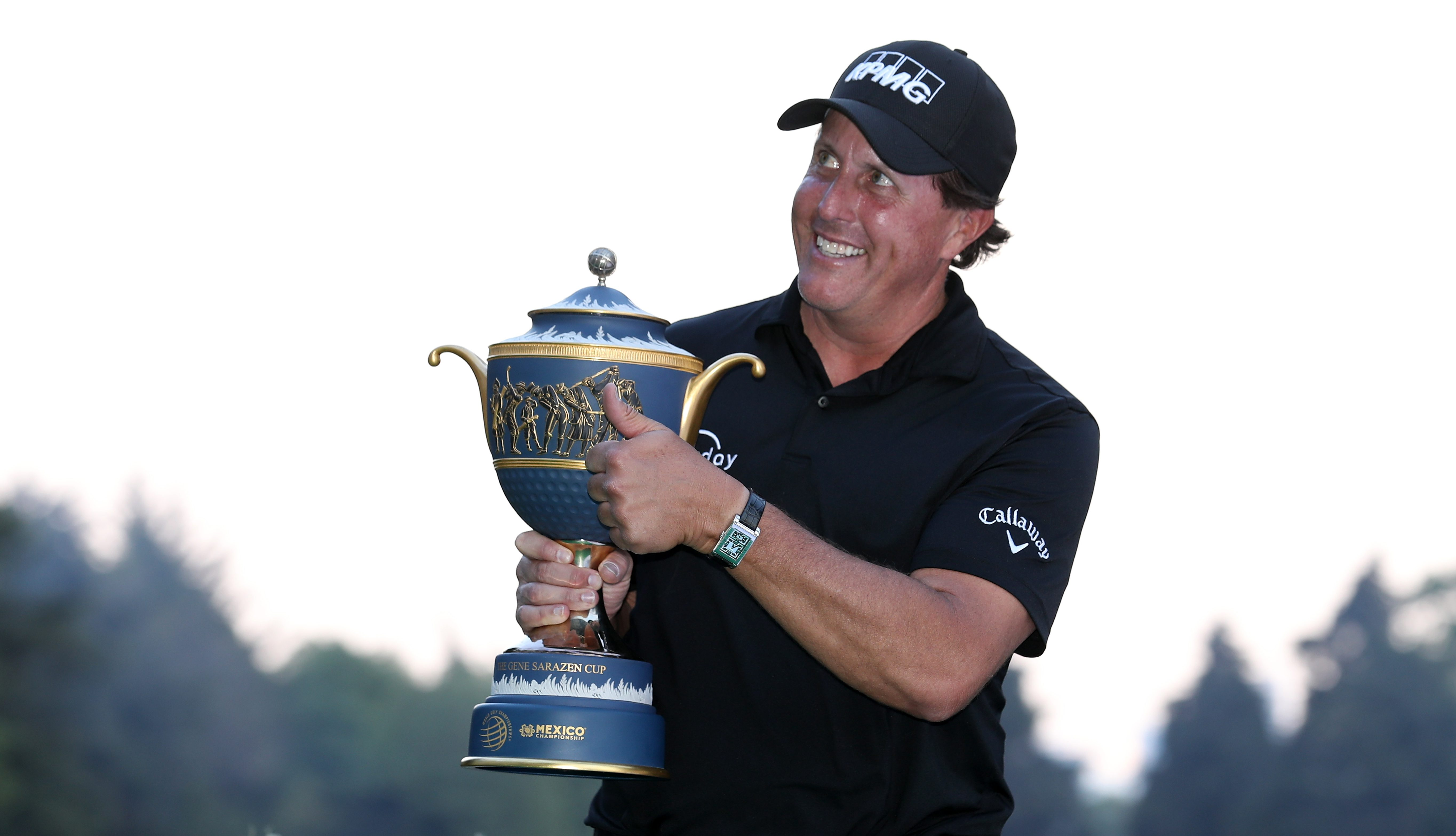 MEXICO CITY, MEXICO - MARCH 04: Phil Mickelson gives a thumb up to fans as he holds the Gene Sarazen Cup after winning the World Golf Championships-Mexico Championship on a playoff hole at Club De Golf Chapultepec on March 4, 2018 in Mexico City, Mexico. (Photo by Rob Carr/Getty Images)