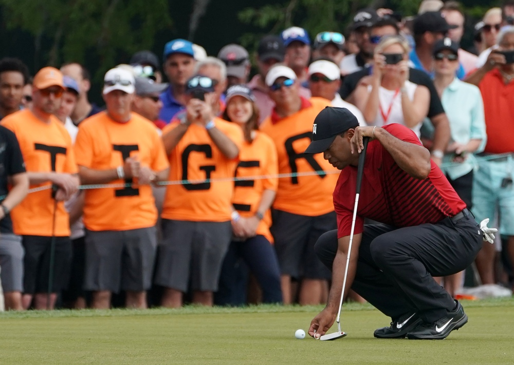 Mar 11, 2018; Palm Harbor, FL, USA; Tiger Woods lines up his putt on the 13th during the final round of the Valspar Championship golf tournament at Innisbrook Resort - Copperhead Course. Mandatory Credit: Jasen Vinlove-USA TODAY Sports