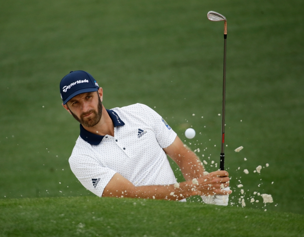 Dustin Johnson hits from a bunker on the second hole during a practice round for the Masters golf tournament Wednesday, April 4, 2018, in Augusta, Ga. (AP Photo/Chris Carlson)
