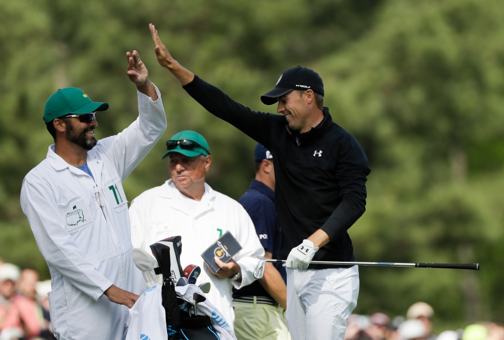 Jordan Spieth celebrates making the green on the 12th hole during the fourth round at the Masters golf tournament Sunday, April 8, 2018, in Augusta, Ga. (AP Photo/David J. Phillip)