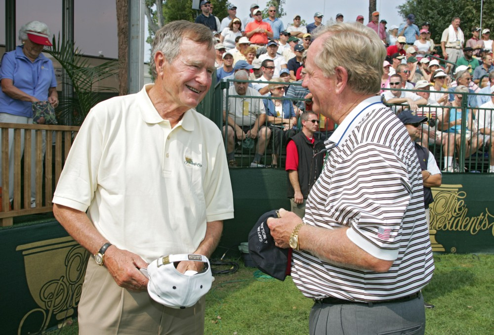 UNITED STATES - SEPTEMBER 23: Former United States President George H.W. Bush talks with U.S. Captain Jack Nicklaus during the second round of The Presidents Cup at Robert Trent Jones Golf Club in Prince William County, Virginia on September 23, 2005. (Photo by Stan Badz/PGA)