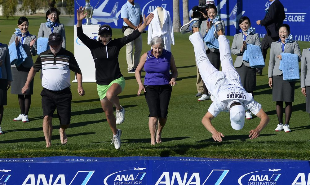 RANCHO MIRAGE, CA - APRIL 02: Pernilla Lindberg of Sweden jumps into the water with her fiance Daniel Taylor and her parents Jan and Gunilla Lindberg after winning the the ANA Inspiration on the Dinah Shore Tournament Course at Mission Hills Country Club on April 2, 2018 in Rancho Mirage, California. (Photo by Robert Laberge/Getty Images)