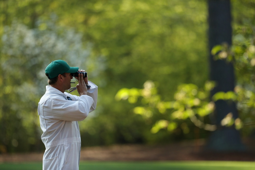 AUGUSTA, GA - APRIL 03: A caddie uses a rangefinder during a practice round prior to the start of the 2018 Masters Tournament at Augusta National Golf Club on April 3, 2018 in Augusta, Georgia. (Photo by Patrick Smith/Getty Images)