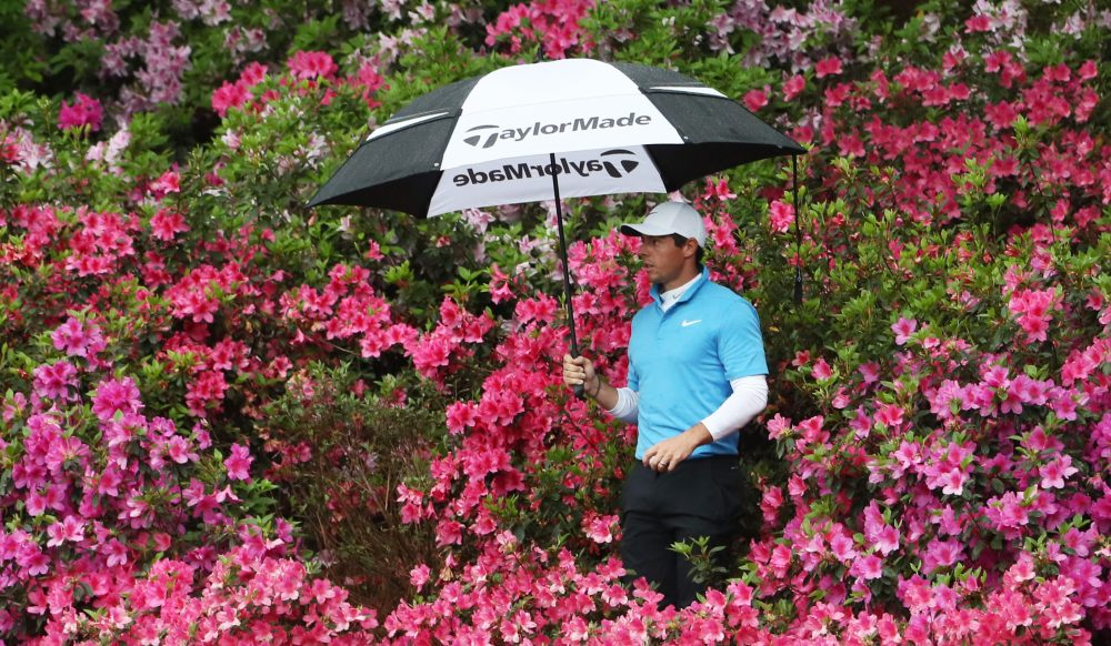 AUGUSTA, GA - APRIL 07: Rory McIlroy of Northern Ireland locates his ball in the flowers on the 13th hole during the third round of the 2018 Masters Tournament at Augusta National Golf Club on April 7, 2018 in Augusta, Georgia. (Photo by Jamie Squire/Getty Images)
