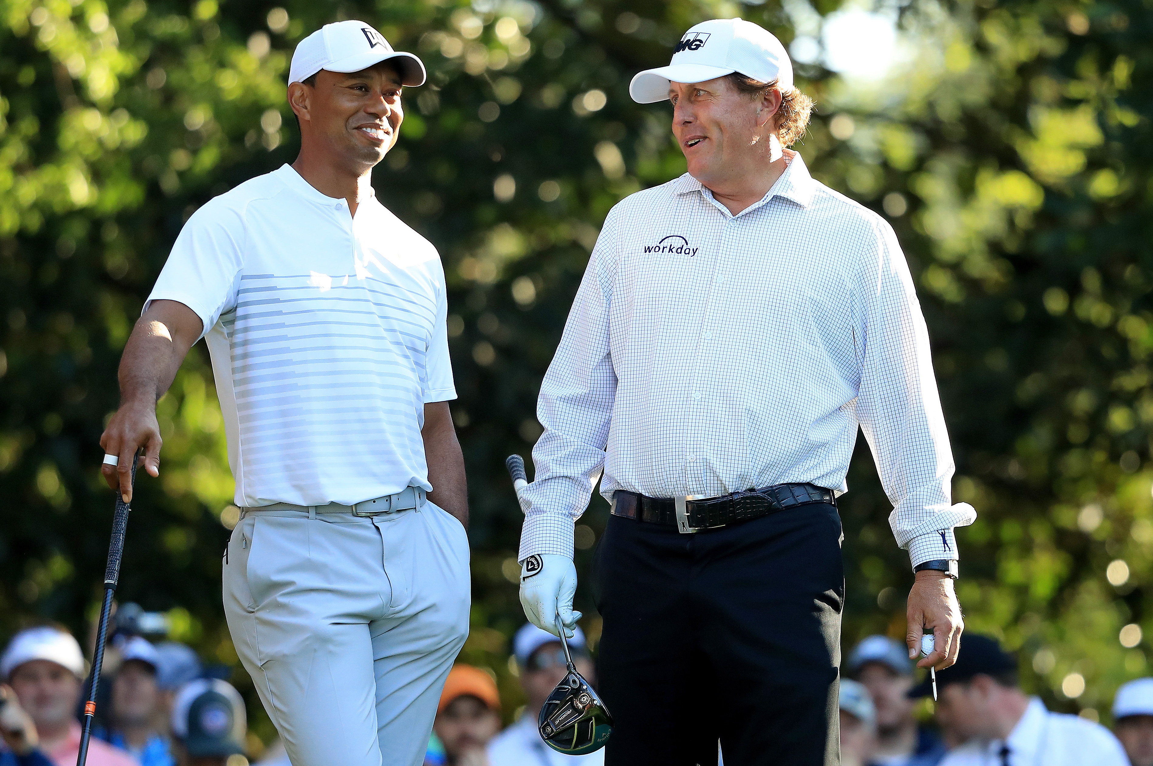 AUGUSTA, GA - APRIL 03: Tiger Woods and Phil Mickelson of the United States talk on the 11th hole during a practice round prior to the start of the 2018 Masters Tournament at Augusta National Golf Club on April 3, 2018 in Augusta, Georgia. (Photo by Andrew Redington/Getty Images)