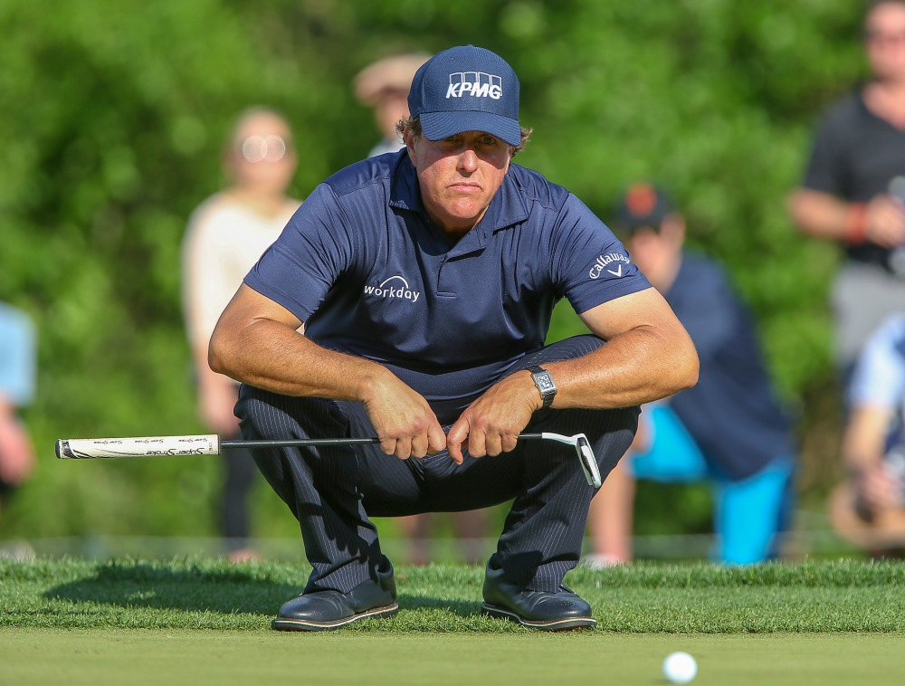 Mar 29, 2018; Humble, TX, USA; Phil Mickelson of the United States sets up his putt on the tenth green during first round of the Houston Open golf tournament at Golf Club of Houston - The Tournament Course. Mandatory Credit: John Glaser-USA TODAY Sports