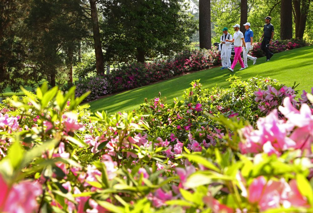 Apr 3, 2018; Augusta, GA, USA; Wesley Bryan, Jordan Spieth and Bubba Watson walk off the 6th tee box during a practice round for the Masters golf tournament at Augusta National GC. Mandatory Credit: Rob Schumacher-USA TODAY Sports