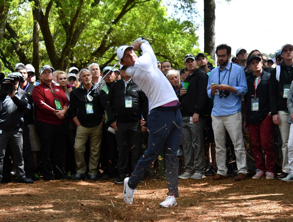 Rory McIlroy hits from the pine straw on the 1st hole. (Michael Madrid-USA TODAY Sports)