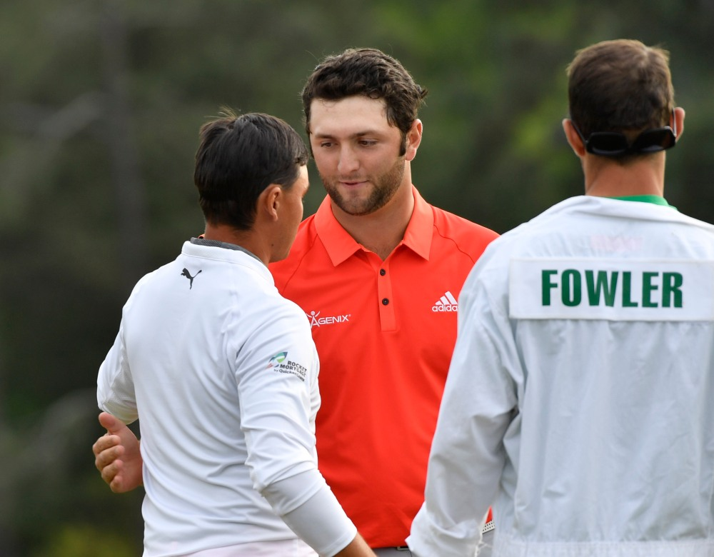 Apr 8, 2018; Augusta, GA, USA; Rickie Fowler (left) greets Jon Rahm on the 18th green during the final round of the Masters golf tournament at Augusta National Golf Club. Mandatory Credit: Michael Madrid-USA TODAY Sports