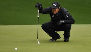 Apr 7, 2018; Augusta, GA, USA; Phil Mickelson lines up a putt on the 10th green during the third round of the Masters golf tournament at Augusta National Golf Club. Mandatory Credit: Michael Madrid-USA TODAY Sports