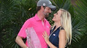 May 13, 2018; Ponte Vedra Beach, FL, USA; Webb Simpson celebrates his wife Taylor Dowd Simpson after winning the final round of The Players Championship golf tournament at TPC Sawgrass - Stadium Course. Mandatory Credit: John David Mercer-USA TODAY Sports