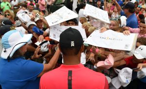 May 13, 2018; Ponte Vedra Beach, FL, USA; Tiger Woods signs autographs for kids after the final round of The Players Championship golf tournament at TPC Sawgrass - Stadium Course. Mandatory Credit: Adam Hagy-USA TODAY Sports