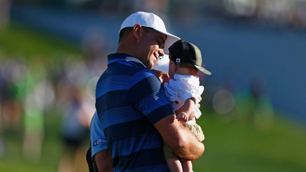 SCOTTSDALE, AZ - FEBRUARY 04: Gary Woodland holds his son, Jaxson, after winning the Waste Management Phoenix Open at TPC Scottsdale on February 4, 2018 in Scottsdale, Arizona. (Photo by Matt Sullivan/Getty Images)