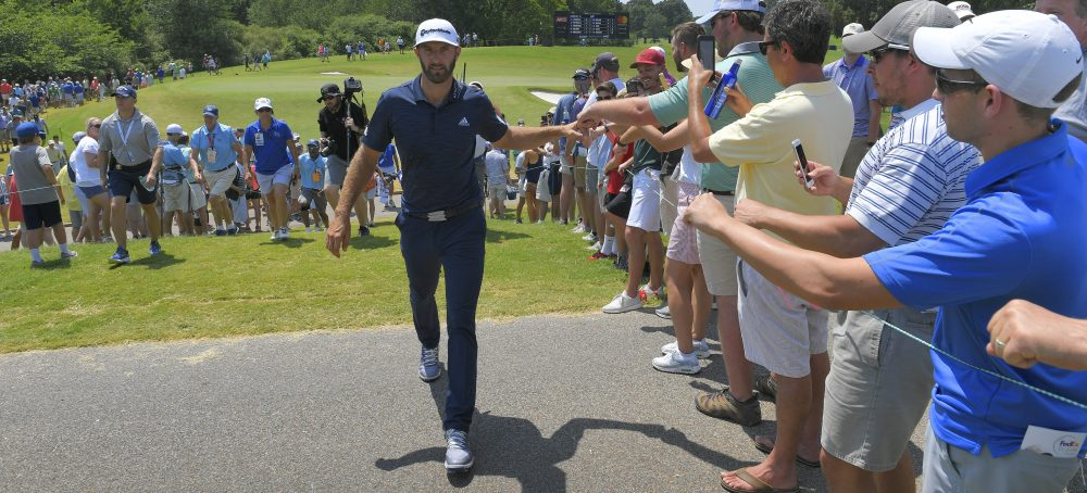 MEMPHIS, TN - JUNE 10: Dustin Johnson fist bumps fans along the ninth hole during the final round of the FedEx St. Jude Classic at TPC Southwind on June 10, 2018 in Memphis, Tennessee. (Photo by Stan Badz/PGA TOUR)