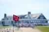 SOUTHAMPTON, NY - JUNE 16: The first hole flag blows in the breeze during the third round of the 2018 U.S. Open at Shinnecock Hills Golf Club on June 16, 2018 in Southampton, New York. (Photo by Ross Kinnaird/Getty Images)
