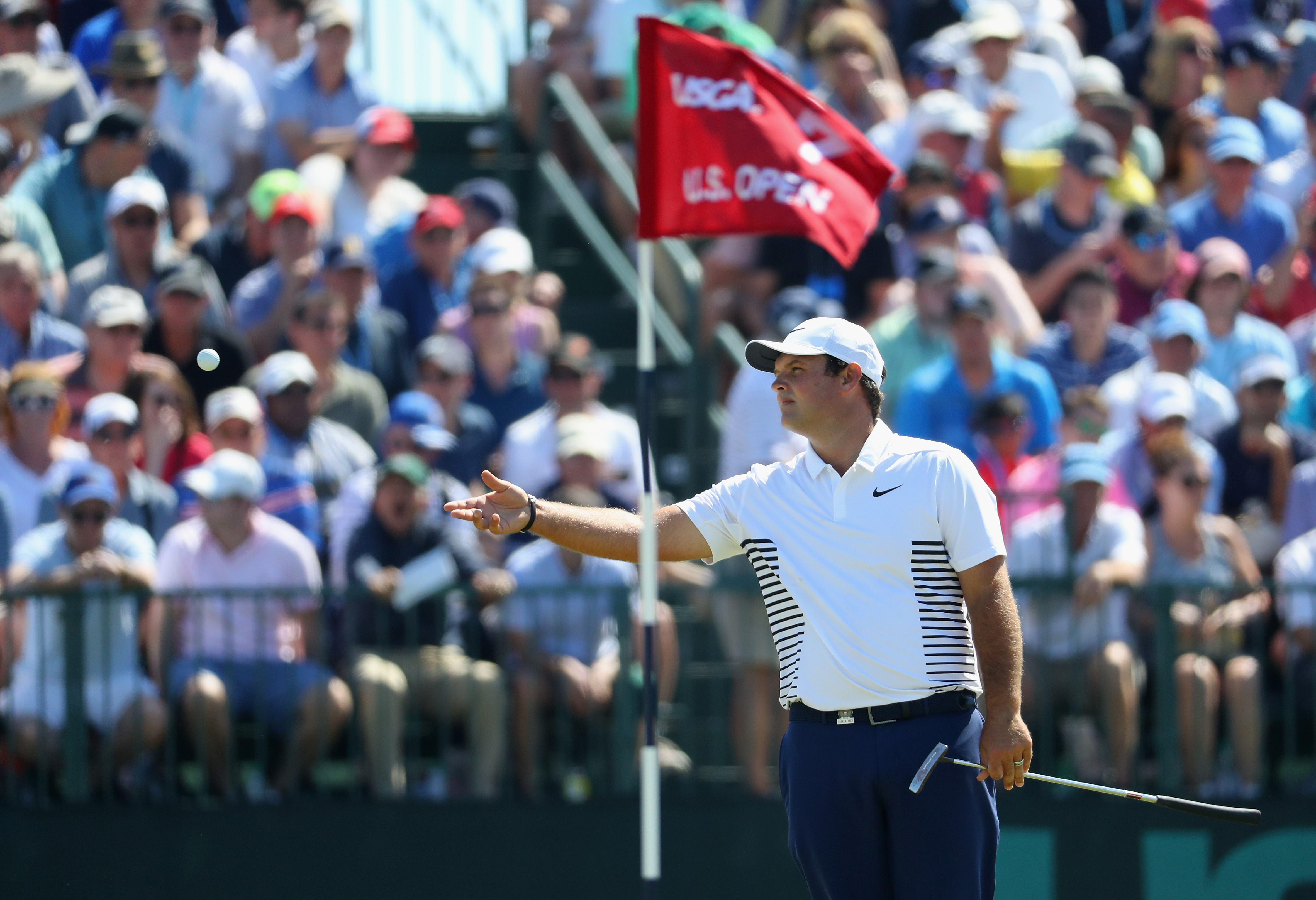 SOUTHAMPTON, NY - JUNE 17: Patrick Reed of the United States gestures to the crowd after making a birdie putt on the seventh green during the final round of the 2018 U.S. Open at Shinnecock Hills Golf Club on June 17, 2018 in Southampton, New York. (Photo by Warren Little/Getty Images)