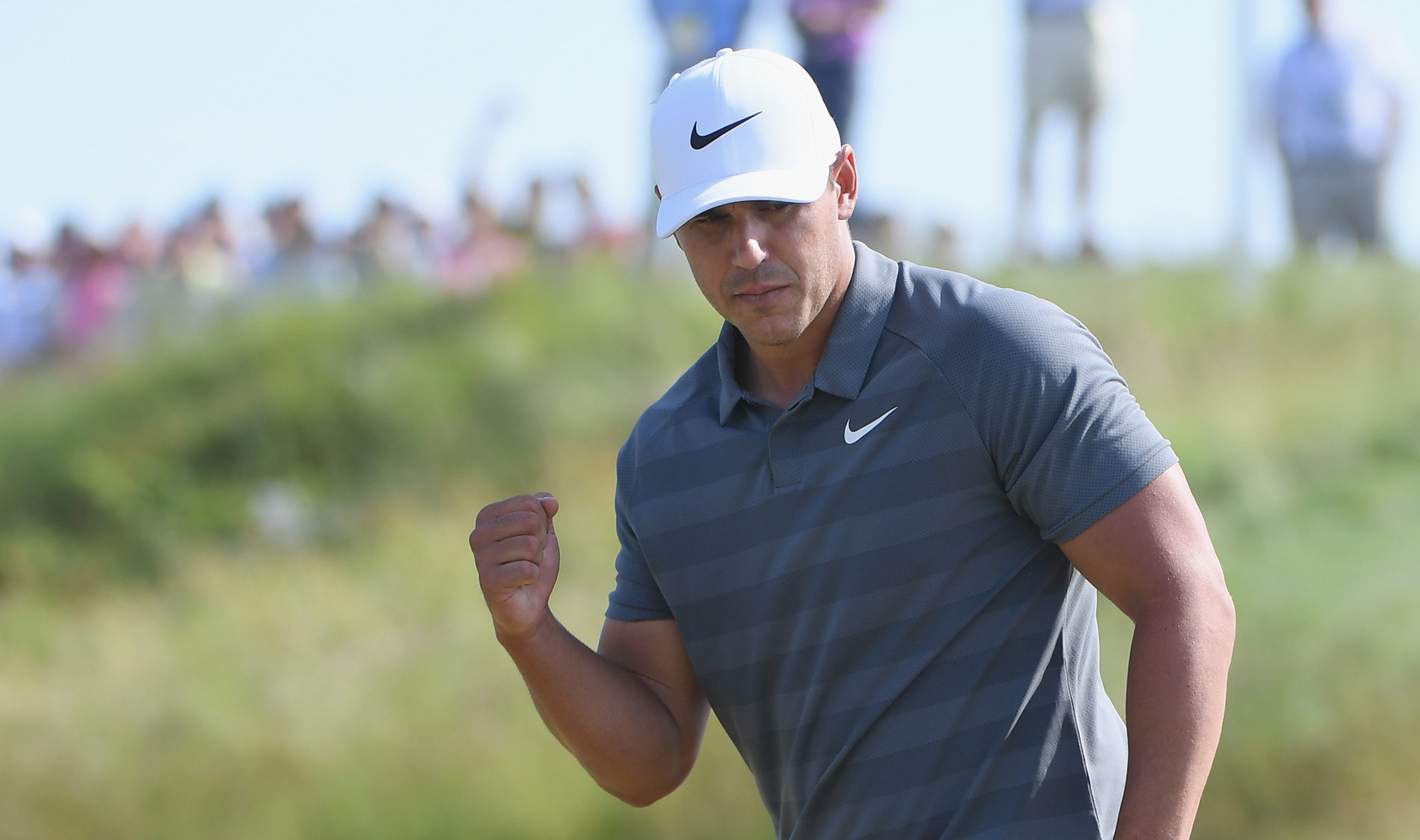 SOUTHAMPTON, NY - JUNE 17: Brooks Koepka of the United States reacts to a putt on the 11th green during the final round of the 2018 U.S. Open at Shinnecock Hills Golf Club on June 17, 2018 in Southampton, New York. (Photo by Ross Kinnaird/Getty Images)