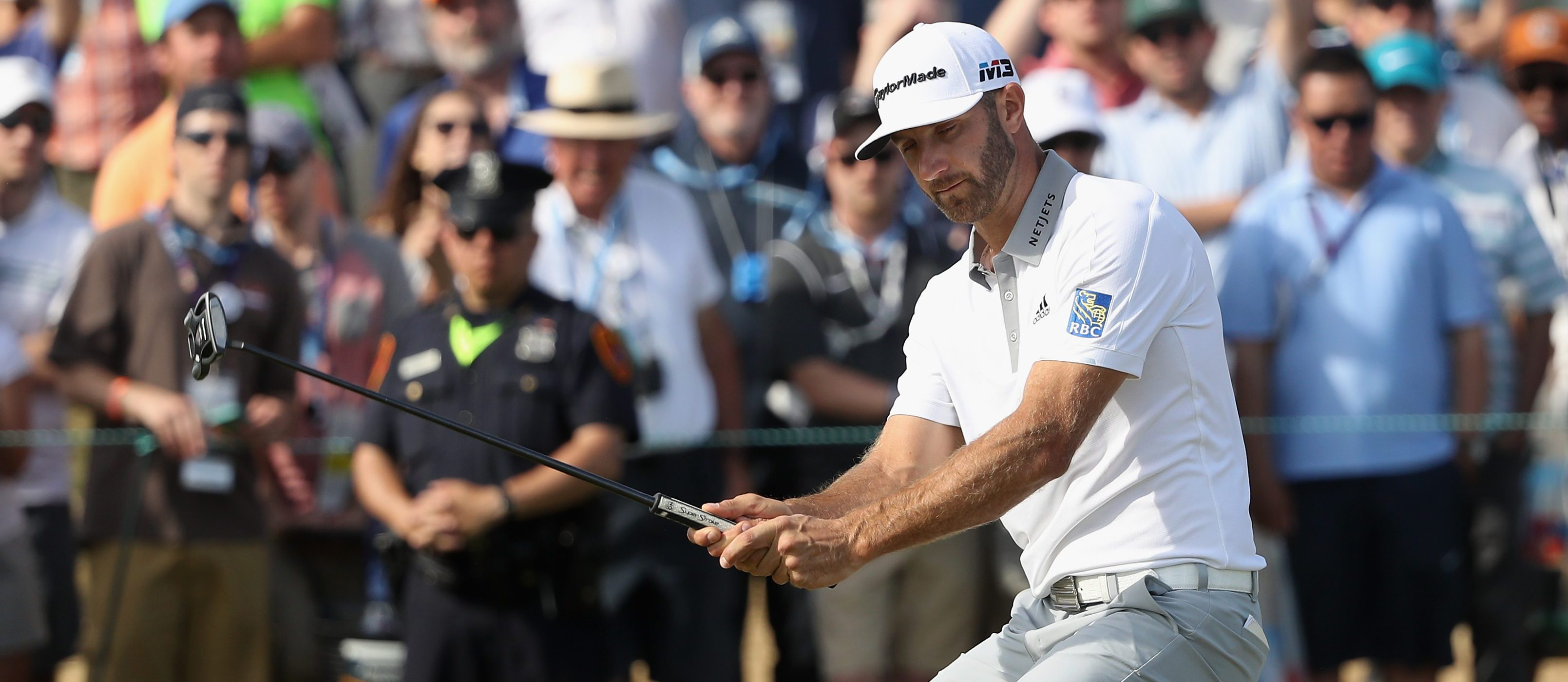 SOUTHAMPTON, NY - JUNE 17: Dustin Johnson of the United States reacts to a missed putt on the 12th green during the final round of the 2018 U.S. Open at Shinnecock Hills Golf Club on June 17, 2018 in Southampton, New York. (Photo by Streeter Lecka/Getty Images)