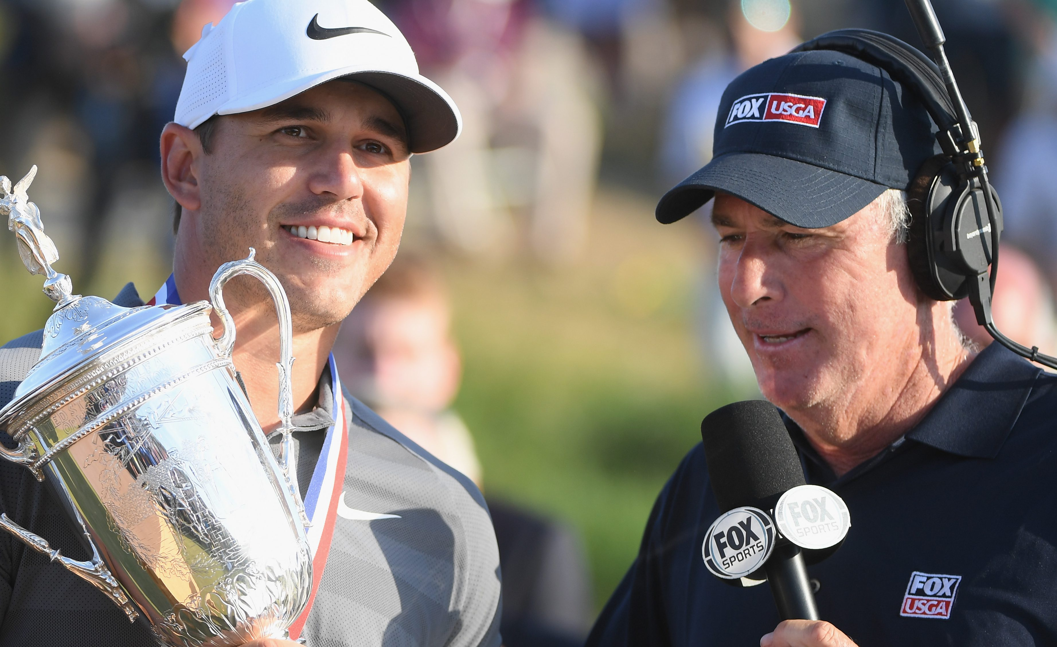 SOUTHAMPTON, NY - JUNE 17: Brooks Koepka of the United States is interviewed during the trophy presentation after winning the 2018 U.S. Open at Shinnecock Hills Golf Club on June 17, 2018 in Southampton, New York. (Photo by Ross Kinnaird/Getty Images)